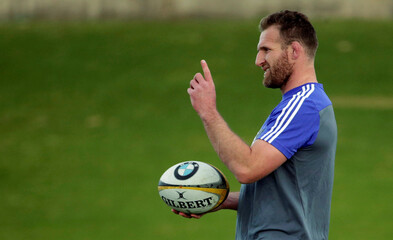 The New Zealand All Blacks rugby team captain Kieran Read holds a ball during a team training session in Sydney