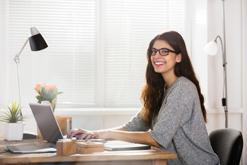 Young Happy Woman At Workplace