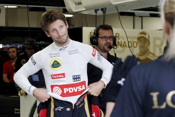 Lotus Formula One driver Grosjean of France reacts in the team garage ahead of the first practice session of the Singapore F1 Grand Prix