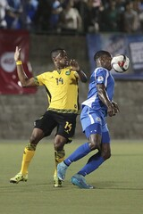 Nicaragua's Copete and Jamaica's Brown fight for the ball during their World Cup qualifier soccer match at the National Stadium in Managua