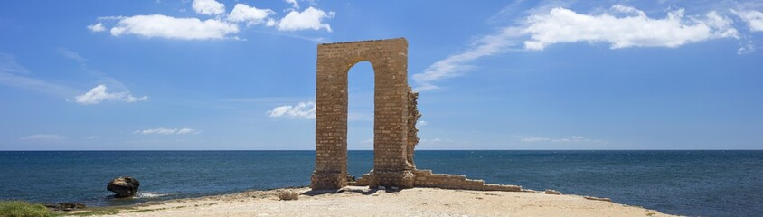 Poster Tunisia panoramic view to stone arch of cape of Africa in Tunisia