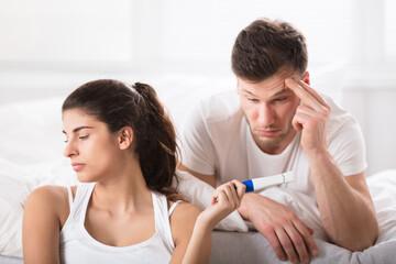 Sad Woman Showing Her Husband Positive Pregnancy-test