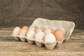 Eggs in a tray on a wooden background