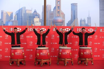 Golfers Henrik Stenson of Sweden, Rickie Fowler, Jordan Spieth and Bubba Watson of U.S. attend a photo call for the WGC-HSBC Champions golf tournament near the Bund in Shanghai