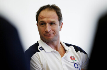 England backs coach Mike Catt during the press conference
