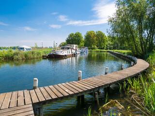 Boats at moorings at Lake Brielse Meer, Netherlands
