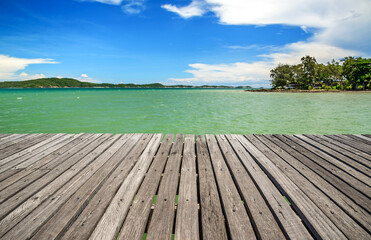 Beautiful wooden bridge in Thailand. Bridge extends into the sea.