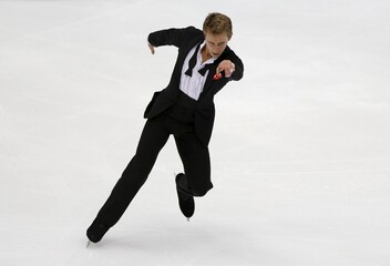 Michal Brezina of the Czech Republic performs during the men's singles short program at the ISU Grand Prix of Figure Skating in Nagano, Japan