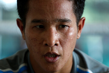 Thailand's boxer Peamwilai Laopeam, who hopes to win gold at the Rio Olympics, looks on after a training session at a gym in Bangkok