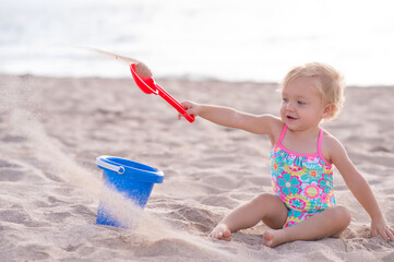 One Year Old Girl Playing in the Sand