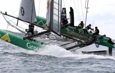 AC45F racing sailboat Groupama Team France rounds the leeward mark in race 2 during the America's Cup World Series sailing competition on the Great Sound in Hamilton