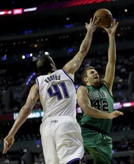 David Lee of Boston Celtics jumps for the ball with Kosta Koufos of Sacramento Kings during their NBA Global Games basketball game in Mexico City