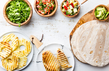 ingredients for mexican chicken tacos with vegetables and grilled pineapple