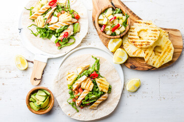 Mexican food. Chicken tacos street tacos with grilled pineapple and vegetables on white background