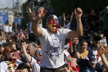 Fans react after Germany goal as they watch a EURO 2016 Round of 16 soccer match in Paris