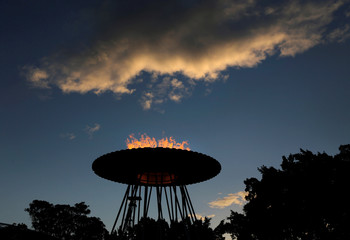 The Sydney Olympic cauldron is seen re-lit at sunset