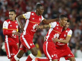 Meza of Colombia's Santa Fe celebrates with teammates after scoring a goal against Argentina's Independiente  during their Copa Sudamericana match in Bogota