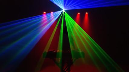 Disc jockey, DJ, silhouette with laser light