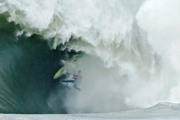 Allport wipes out on a wave during the Cape Fear surfing tournament in heavy seas off Sydney's Cape Solander in Australia