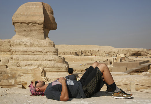 Jordan Cameron of Miami Dolphins rests in front of the Sphinx and Great Pyramids in Giza