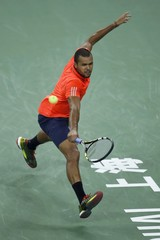 Jo-Wilfried Tsonga of France returns a shot to Rafael Nadal of Spain during their men's singles semi-final match at the Shanghai Masters tennis tournament in Shanghai