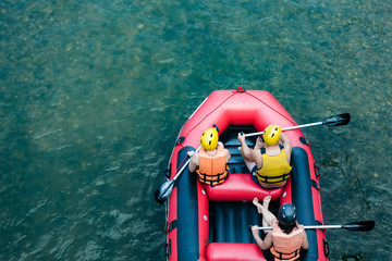 Group of traveler in the inflatable rafting on the river, extreme and fun sport