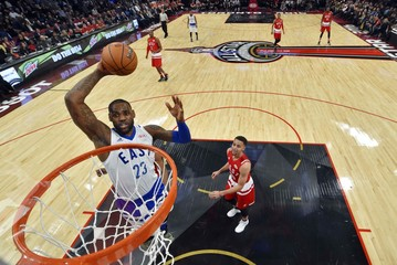 File photo of Eastern Conference forward LeBron James of the Cleveland Cavaliers goes up for a dunk during the NBA  All-Star Game in Toronto