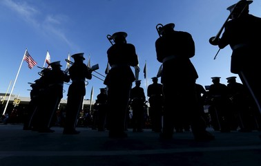 A marching band plays under an American flag at the NFL Experience, a Super Bowl 50 attraction in San Francisco,