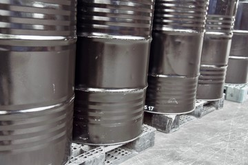 Black Industrial Chemical Drums on Pallets