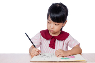 Asian Little Chinese girl drawing with color pencils