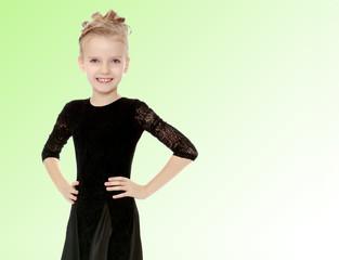 Beautiful little dancer in a black dress.
