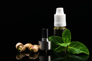Concept of nut and mint flavors for electronic cigarettes on a black background