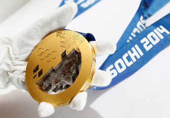 Gold medal manufactured for 2014 Winter Olympic Games in Sochi is seen on display at Adamas jewellery factory in Moscow