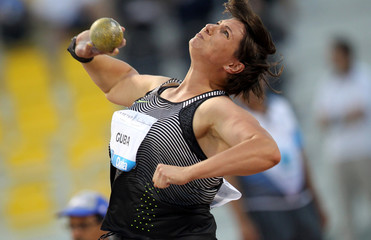 Paulina Guba competes in the Shot Put event at the IAAF Diamond League athletics meet, in Doha