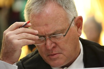 Defence lawyer Barry Roux is seen before an appeal by state prosecutors against Pistorius's conviction last year at the Supreme Court of Appeal (SCA) in Bloemfontein,