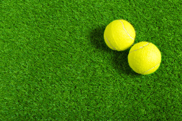 Tennis ball on green grass