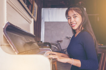 pretty girl playing the ancient piano.