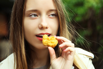 girl is eating nuggets