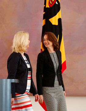 Outgoing Family Minister Manuela Schwesig (L) and new appointed Family Minister Katarina Barley smile during a ceremony to change office at Bellevue Castle in Berlin