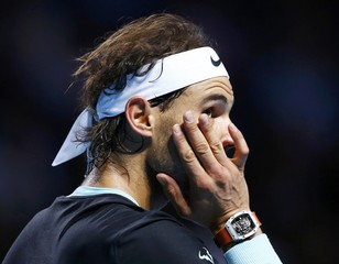 Nadal of Spain reacts during his match against Switzerland's Federer at the Swiss Indoors ATP men's tennis tournament in Basel