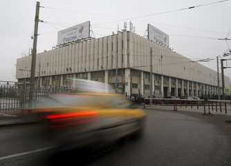 Cars drive near the Russian Olympic Committee headquarters, which also houses the management of Russian Athletics Federation in Moscow