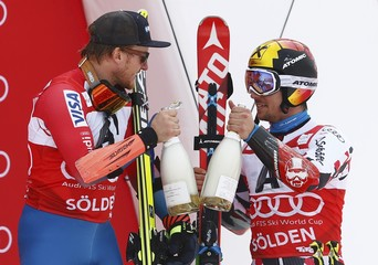Ligety of the U.S. and Hirscher of Austria shake sparkling wine after the alpine World Cup men's giant slalom race on the Rettenbach glacier in the Tyrolean ski resort of Soelden