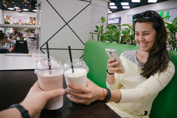 first-person view on woman taking picture of smoothie