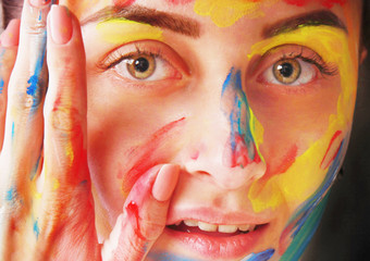 Bright beautiful girl with art colorful make-up