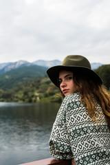 Young stylish girl on nature posing
