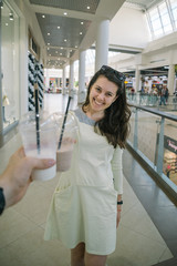 Woman Drinking Smoothie while walking the mall