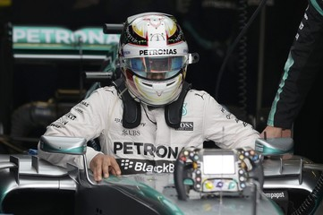Mercedes driver Lewis Hamilton, of Britain, gets out of his car before the Formula One U.S. Grand Prix auto race at the Circuit of the Americas in Austin