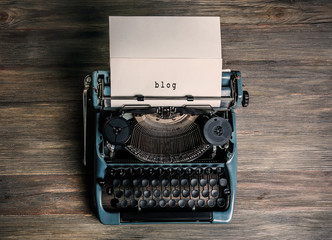 Vintage typewriter on a wooden background