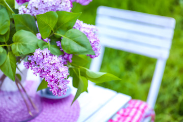 Beautiful lilac flowers on table, closeup