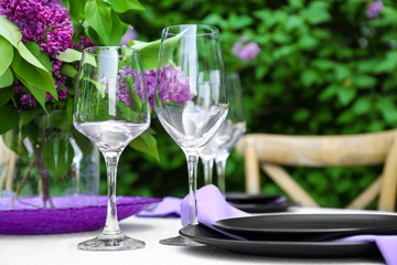 Table setting for dinner in beautiful lilac garden